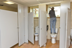 A volunteer working on the bathrooms