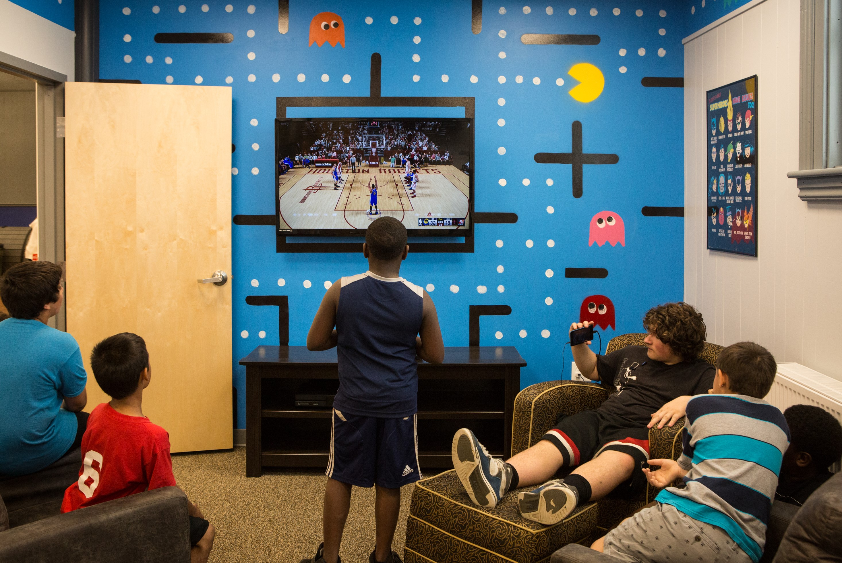 MPAL students wasted no time before utilizing their new game room located off the community room in the Michael Briggs Community Center which opened its doors for the first time since February when Building on Hope's extreme-makeover style renovation began. (Photo: John Benford Photography)