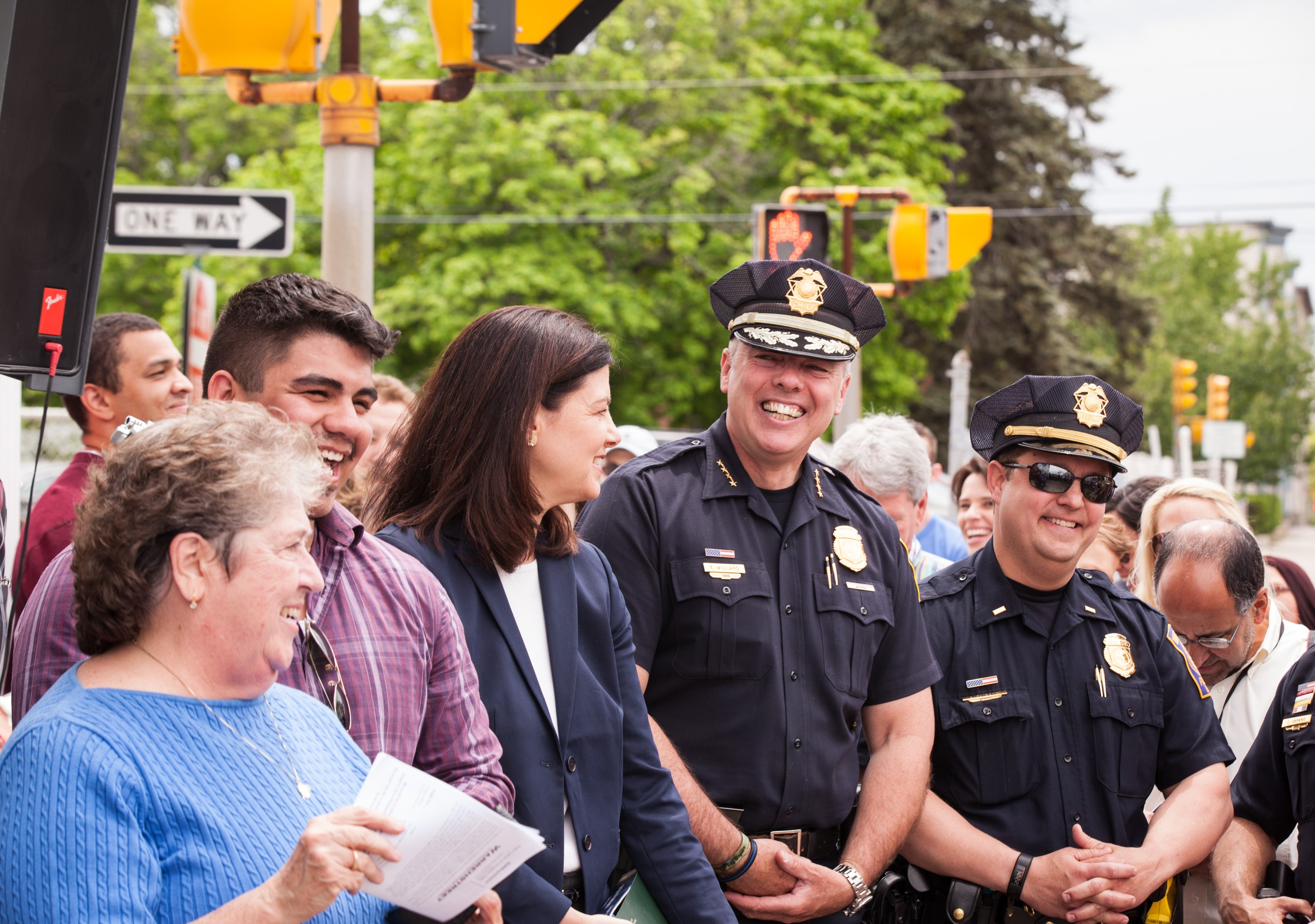 Pictured from left to right, MaryAnn Briggs (mother of Michael Briggs who the building is named for), Gibran Ortiz Perez (MPAL boxing coach), US Senator Kelly Ayotte, Manchester Police Chief Nick Willard and Manchester Police Lieutenant Brian O'Keefe celebrate the kick-off of Building on Hope's Reveal Day at MPAL. (Photo: John Benford Photography)