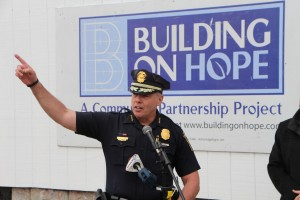 Photo 2: Manchester Police Chief Nick Willard thanks Building on Hope in front of the dozens who came to the Michael Briggs Community Center on Monday during the groundbreaking celebration outside of the MPAL building on Monday.