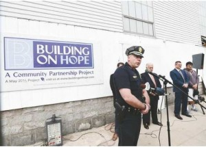 Manchester Police Chief Nick Willard speaks at the ground breaking for Manchester Police Athletic League's Michael Briggs Community Center in Manchester on Monday. The organization Building on Hope arranged $1 million worth of renovations for the inner city youth center on Lake Avenue in Manchester. (DAVID LANE/UNION LEADER)