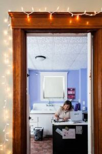 Executive Director Paula Kelley-Wall works from her shared office, which is also a working kitchenette, at the Crisis Center of Central New Hampshire on Wednesday, Feb. 14, 2018. (ELIZABETH FRANTZ / Monitor staff) Elizabeth Frantz / Monitor staff